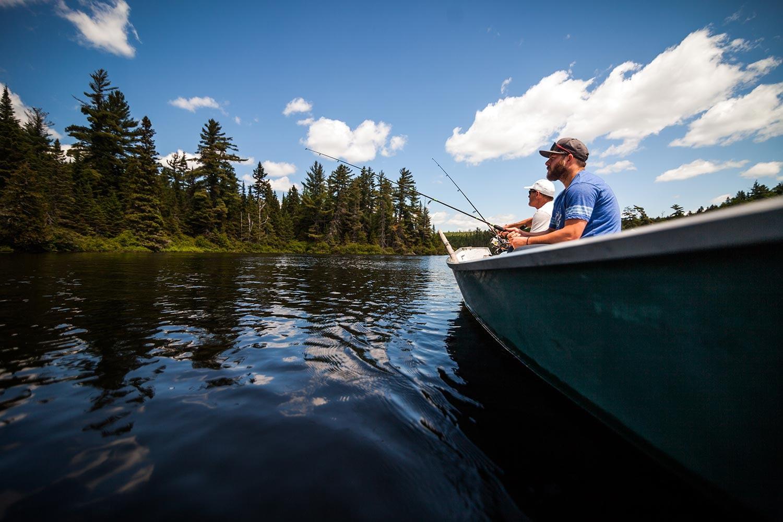 sun-and-father-fishing-in-a-calm-lake-in-wild-natu-PPLPHJY-resize.jpg