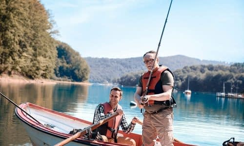 son-and-father-bonding-during-fishing-on-jetty-8FUD5A6-resize.jpg